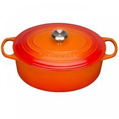 Чугунная кастрюля овальная для запекания (жаровня) с крышкой от Le Creuset, 31 см, цвет оранжевая лава